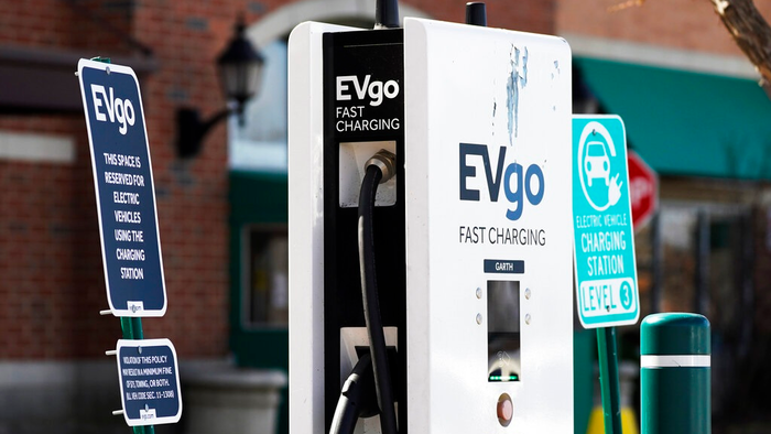 A EVgo electric vehicle charging station is seen at Willow Festival shopping plaza parking lot in Northbrook, Ill., Wednesday, March 31, 2021. President Joe Biden will unveil his $2 trillion infrastructure plan and the proposal calls to build a national network of 500,000 electric vehicle chargers by 2030 and replace 50,000 diesel public transit vehicles.